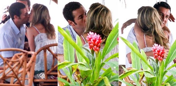 Os atores Adam Sandler e Jennifer Aniston se beijam durante filmagem de 