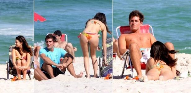 Fernanda Paes Leme e Thiago Gagliasso tomam vento na praia da Barra