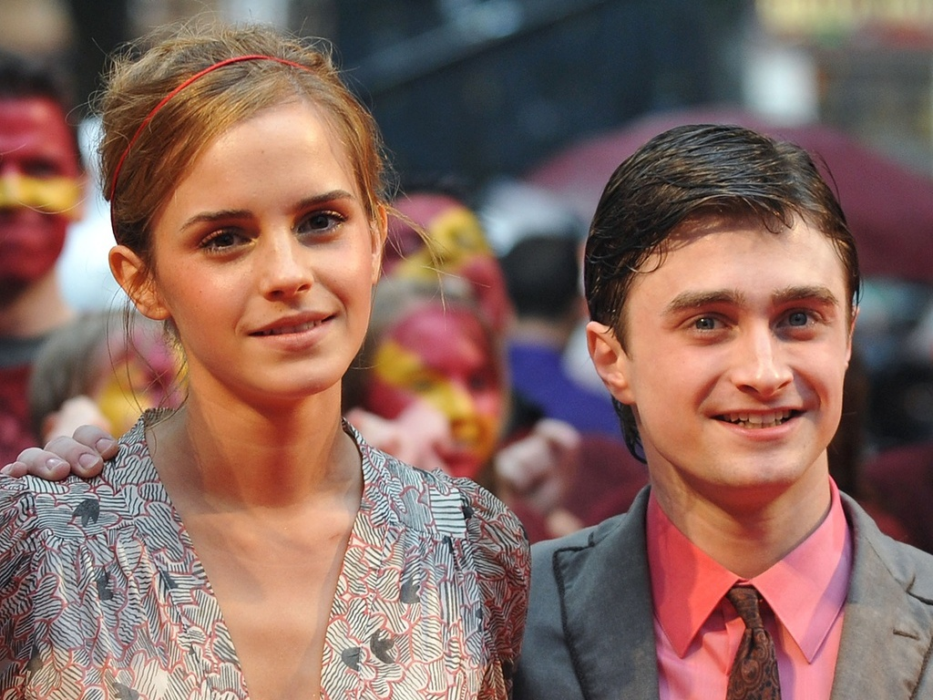 Emma Watson e Daniel Radcliffe em première de