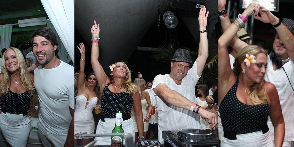 Susana Vieira passa a virada do ano em Santa Catarina, na festa do club Green Valley em um resort na praia do Estaleirinho. Animada, a atriz dançou ao lado do filho, Rodrigo Vieira, que foi um dos DJs da festa, e do namorado, Sandro Pedroso (31/12/2010)