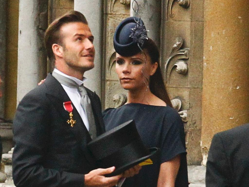 O jogador David Beckham e sua mulher, Victoria Beckham, chegam à Abadia para o Casamento Real (29/4/11)