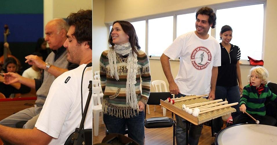 Acompanhado da mulher Vanessa Lóes e do filho Gael, o ator Thiago Lacerda participa de ensaio aberto da Orquestra Sinfônica de Heliópolis, em São Paulo (16/5/2011)