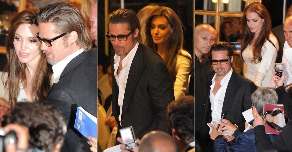 Angelina Jolie e Brad Pitt são cercados pelos paparazzi e por fãs na saída de um restaurante em Cannes (15/5/2011)