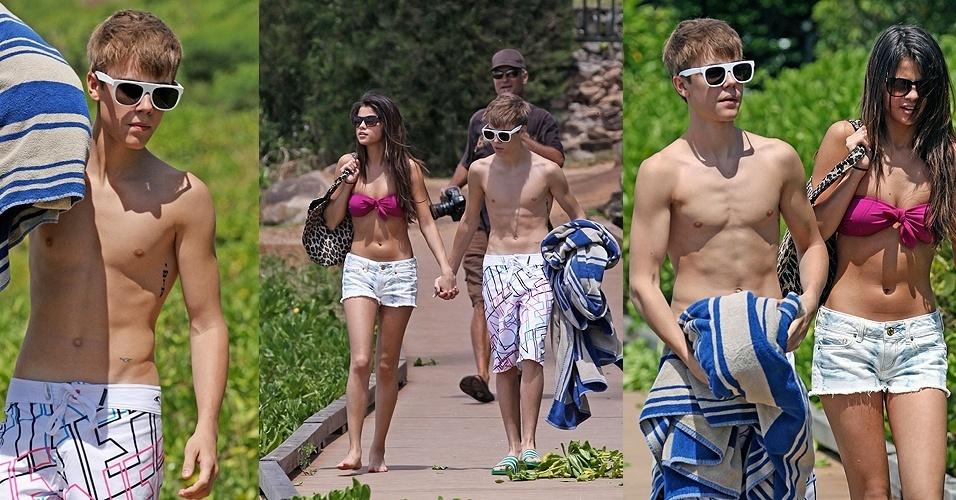 Depois de participarem do Billboard Music Awards, Justin Bieber e a namorada Selena Gomez vão para Maui, no Havaí, para pegar uma praia. Sem camiseta, o cantor exibe algumas de suas tatuagens (23/5/11)