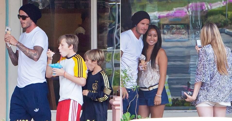 Enquanto Victoria Beckham aguarda o nascimento da filha, David distrai os filhos Brooklyn e Cruz, levando-os para tomar sorvete. De quebra, o jogador de futebol tirou umas fotinhos com as fãs que o abordaram (8/7/11)