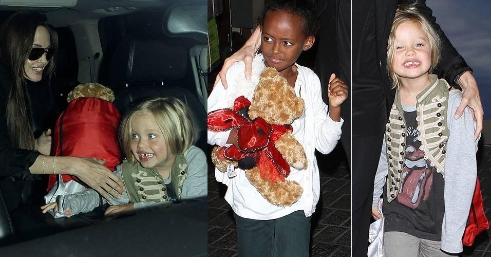 Vindo de Londres, a atriz Angelina Jolie chega no aeroporto do Los Angeles com as filhas Zahara (6) e Shiloh (5), que tem estilos bem diferentes (13/7/11)