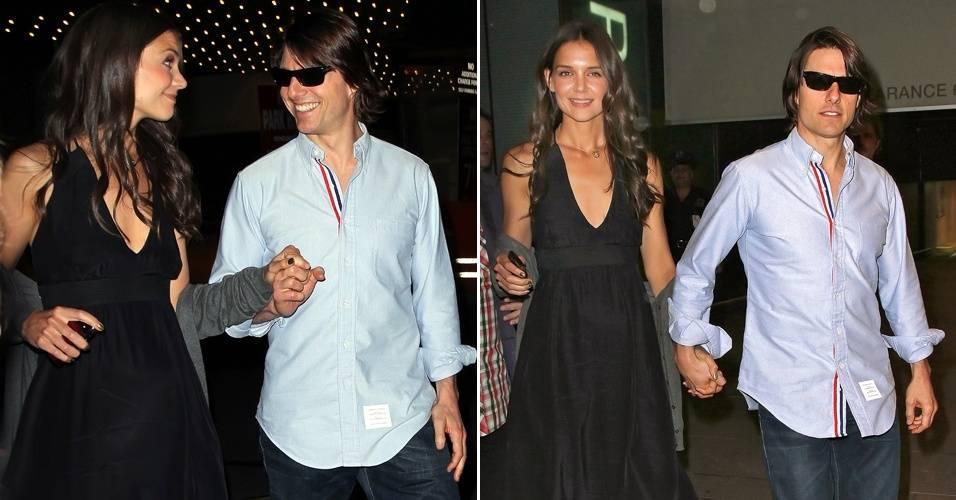 O casal de atores Katie Holmes e Tom Cruise deixa o restaurante Lincoln, no Lincoln Center, em Nova York (8/8/11)