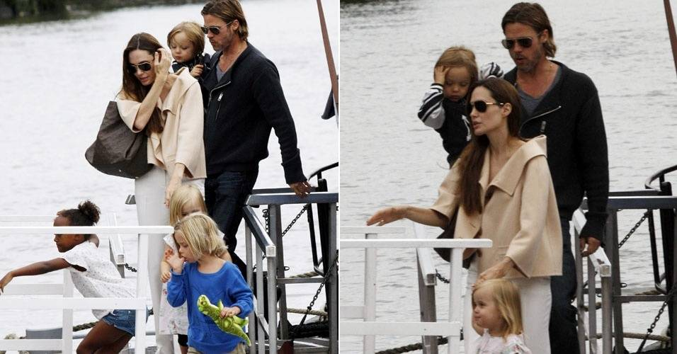 Angelina Jolie e Brad Pitt são fotografados ao sair de barco, em Londres (13/8/11)