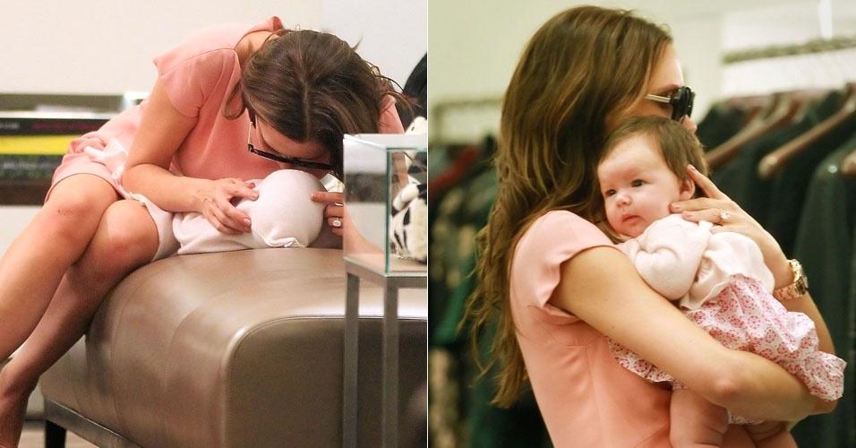 Na loja da Prada, Victoria Beckham mima a caçula Harper (15/9/11)