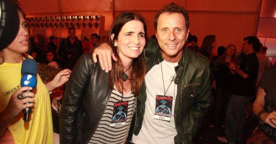 A atriz Malu Mader e o músico Tony Bellotto chegam ao camarote do Rock in Rio. Bellotto se apresentou com sua banda o Titãs, nesta primeira noite do festival (23/9/11)