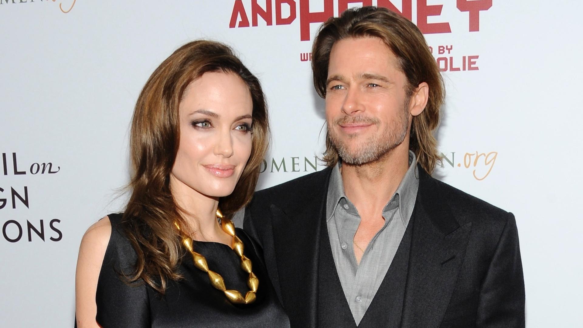 Angelina Jolie e Brad Pitt na pré-estreia do primeiro filme dirigido pela atriz,