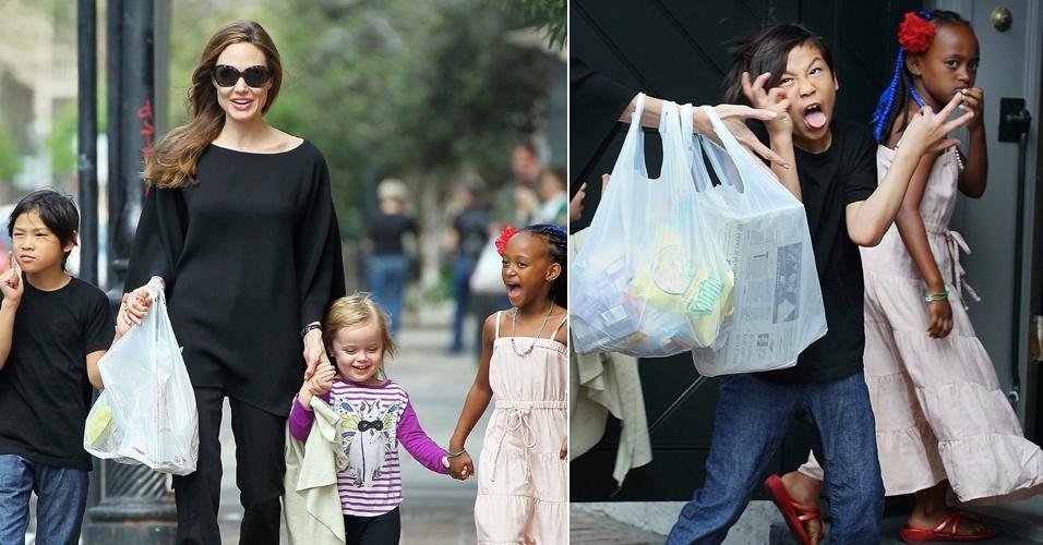Ao lado da família, filho de Angelina Jolie faz careta para paparazzi (11/3/12)