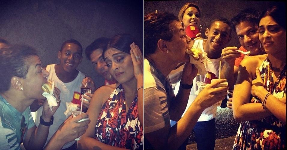 """De regime para viver """"Gabriela"""" na TV, Juliana Paes resiste às guloseimas oferecidas pelos amigos, após sair da quadra da Viradouro, no Rio de Janeiro. """"Ahhhhhhh Coitada!!!! Louca pra comer mas não pode!kkkkkkkk"""", escreveu David Brazil em seu Twitter (24/1/12)"""