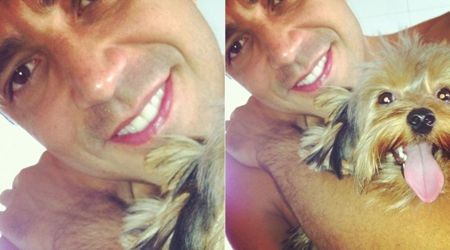 Latino posa abraçado ao seu cãozinho, o yorkshire  Pocker (26/1/12)