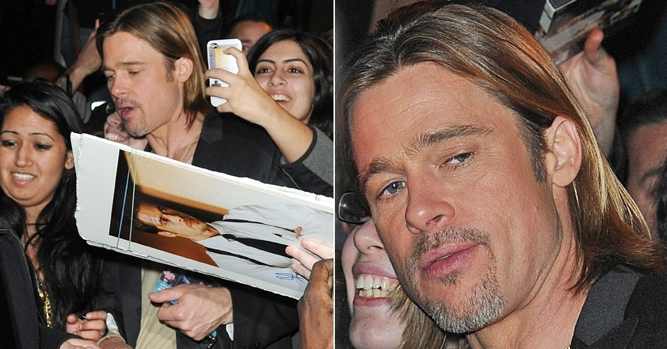 O gal&#227; Brad Pitt &#233; cercado pelos f&#227;s ao sair de est&#250;dio em Nova York (31/1/12)