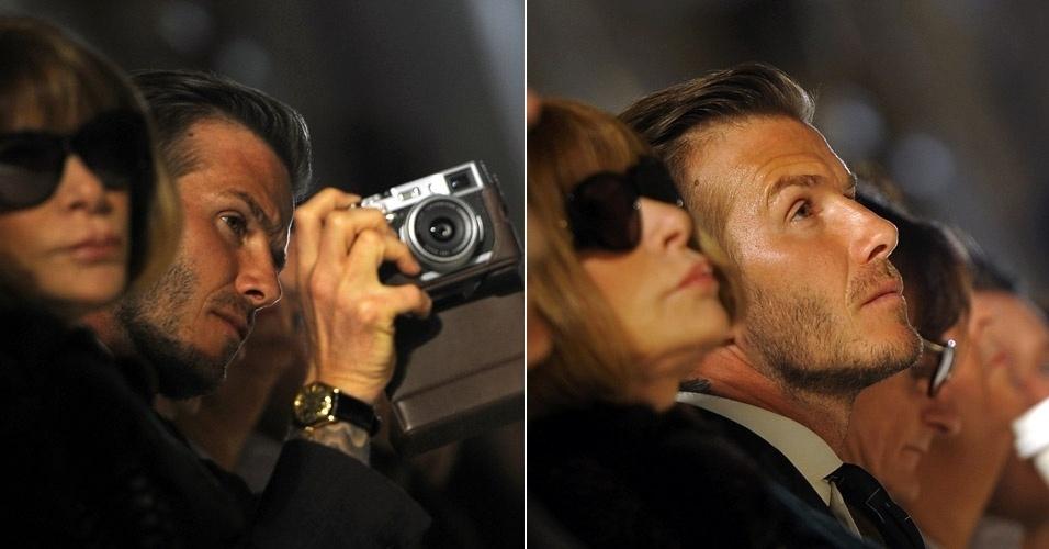 David Beckham prestigia o desfile da mulher, Victoria Beckham, e tira diversas fotos do evento durante a Semana de Moda de Nova York (12/2/12)