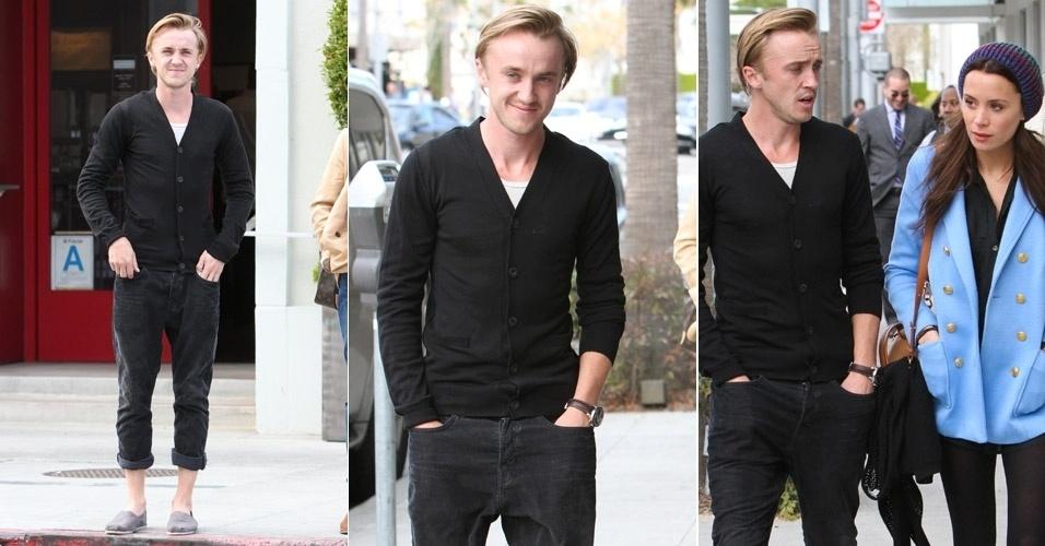 """Com uma calça dobrada e de espadrilhas, Tom Felton, o Draco Malfoy, o bruxo maldoso da saga """"Harry Potter"""" passeia pelas ruas de Beverly Hills com familiar. O ator se sorriu para o paparazzi, ele atua desde dos oito anos (29/2/12)"""