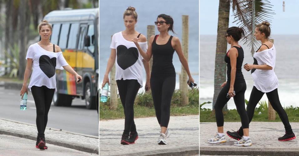 Na 31ª semana de gravidez, a atriz Grazi Massafera caminha na orla da Barra da Tijuca ao lado da também atriz Ana Lima (19/3/12)
