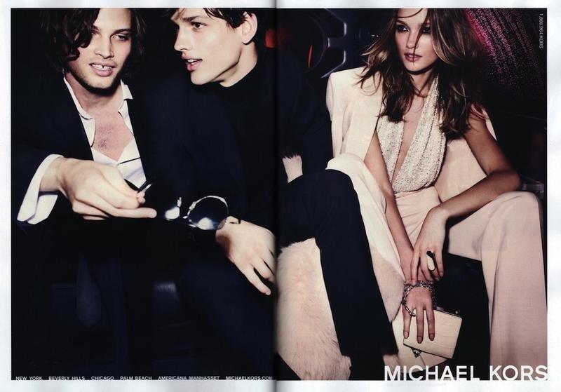 Julho 2011:  No Preview da campanha de Inverno 2011 da Michael Kors, Mario Testino fotografou os modelos Taylor Fuchs, Simon Nessman e Karmen Pedaru