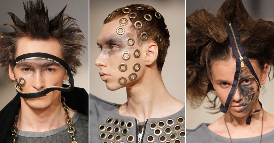 Modelos usam maquiagem com aplicações de zíperes e ilhoses no rosto em desfile que teve temática punk durante a semana de moda da Ucrânia (18/03/2012)