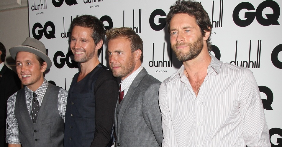 Os integrantes do Take That Mark Owen, Jason Orange, Gary Barlow e Howard Donald no prmio GQ Men Of The Year Awards no The Royal Opera House, em Londres (08/09/2009)
