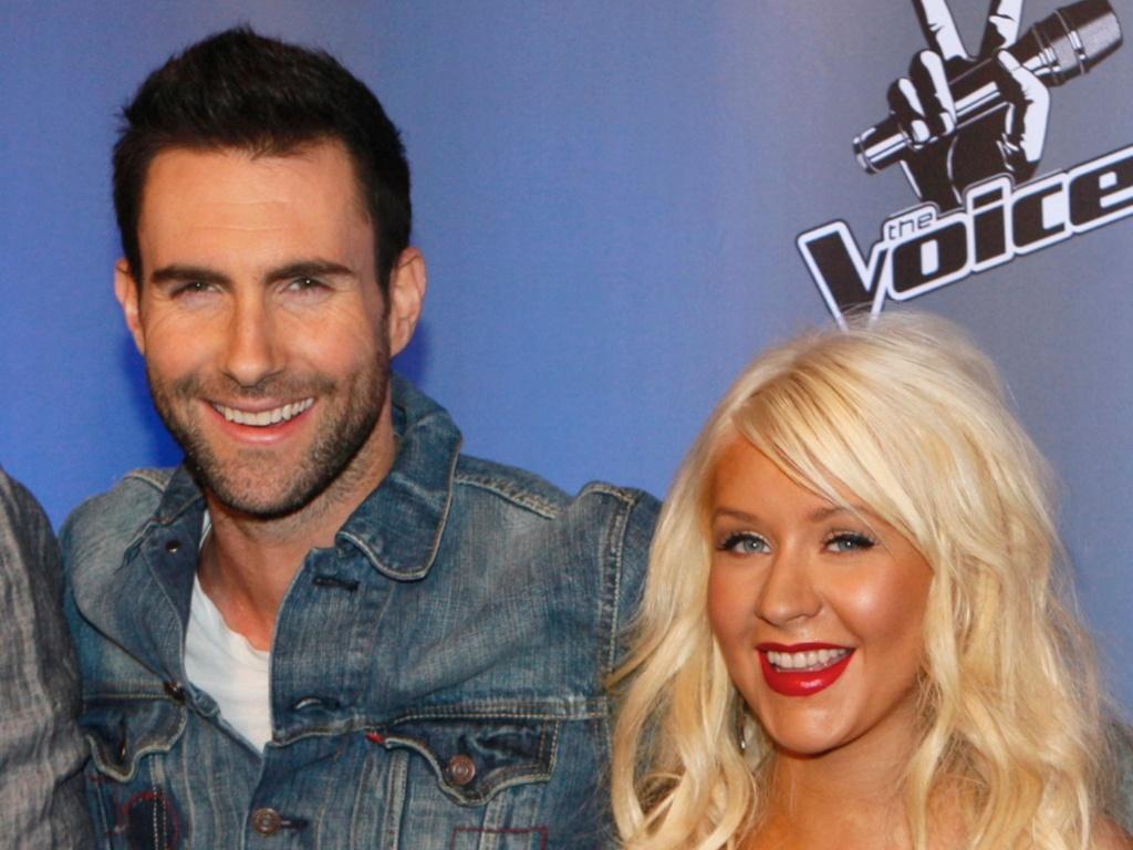 Adam Levine, do Maroon 5 e Christina Aguilera em foto de arquivo do programa