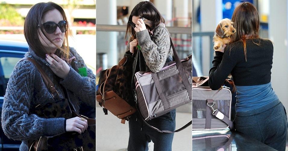 A atriz Leighton Meester se esconde de fotógrafo no aeroporto de Los Angeles (25/1/2011)
