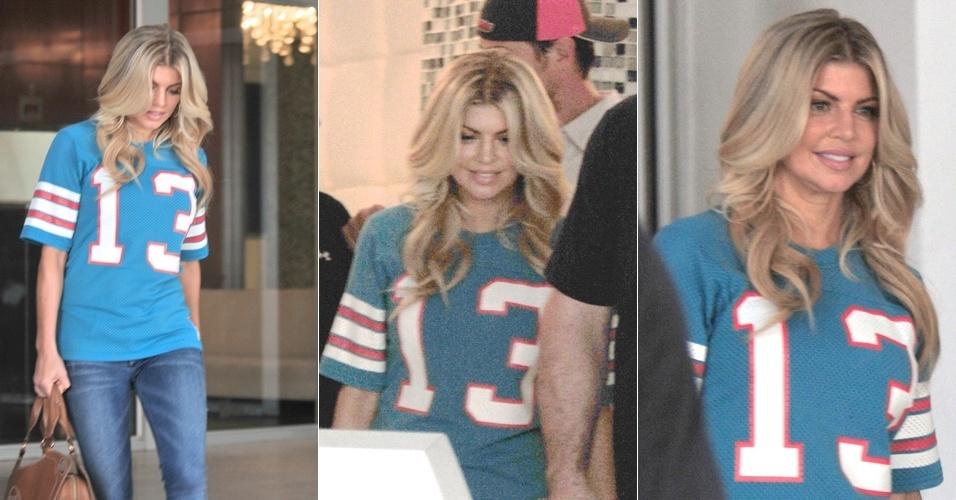 A cantora Fergie, do Black Eyed Peas, vai ao jogo de futebol americano entre o time de Miami, os Miami Dolphins, e os New England Patriot (12/9/11)