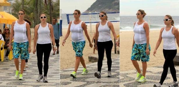 Grávida de sete meses, Luana Piovani caminha pela orla da praia no Rio de Janeiro (9/1/2012)