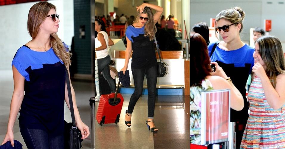 """Grazi Massafera exibe """"barriguinha"""" de cinco meses no aeroporto Santos Dumont, no Rio de Janeiro. A atriz tirou fotos com fãs. Grazi participa nesta segunda-feira de um evento para divulgar uma marca de calçados em São Paulo (16/1/12)"""