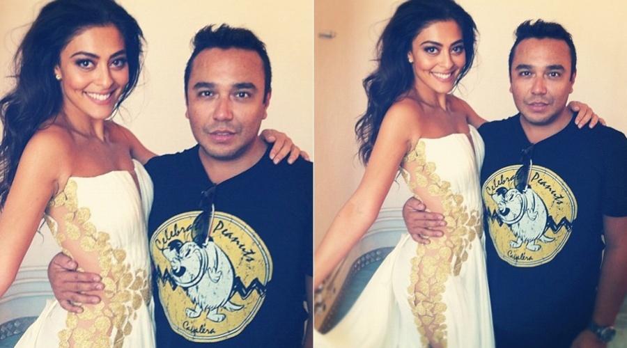 Juliana Paes posa ao lado do produtor de moda Alê Duprat (23/1/12)