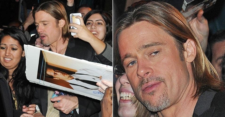 O galã Brad Pitt é cercado pelos fãs ao sair de estúdio em Nova York (31/1/12)