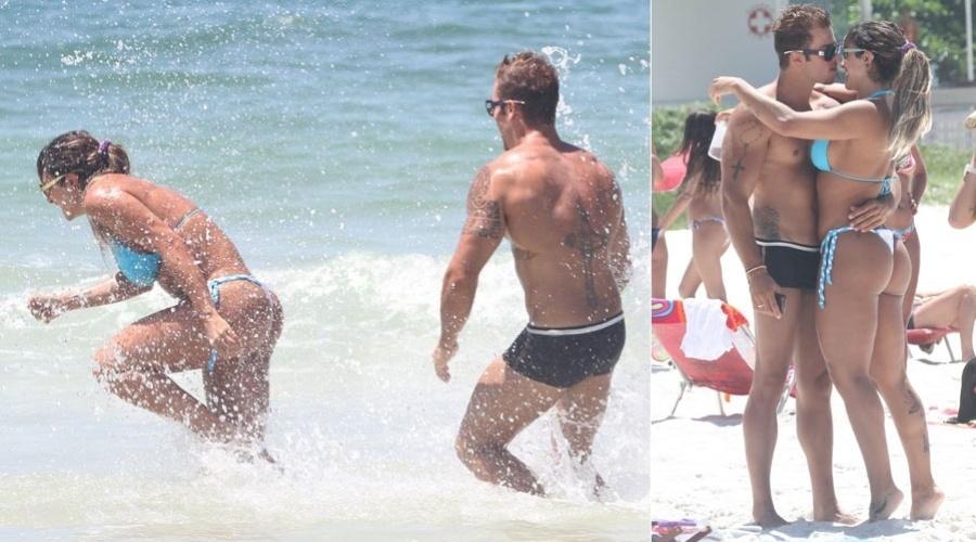 """Jaque Khury e o namorado, Rafael, aproveitaram o sol do Rio de Janeiro para brincarem de """"guerra de água"""" na praia do Pepê nesta sexta-feira. A panicat exibiu sua boa forma (3/2/12)"""