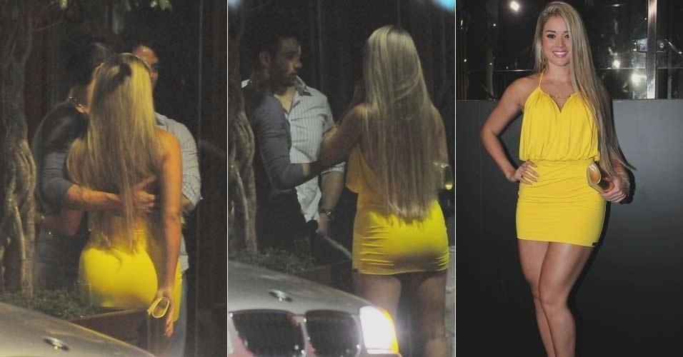 A panicat Ariane Steinkopf e o sertanejo Gusttavo Lima, recém-separado da assistente de palco do Caldeirão do Huck Karen Kounrouzan, conversam abraçados na parte externa da balada, em São Paulo (6/2/12)