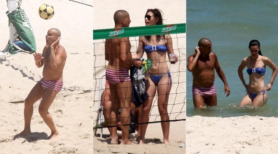 """Eri Johnson joga futevôlei em praia na Barra da Tijuca, na zona oeste carioca. O ator, que atualmente interpreta o personagem Gigante em """"Fina Estampa"""", estava acompanhado de uma morena. Após tomarem sol, eles mergulharam juntos (15/2/12)"""
