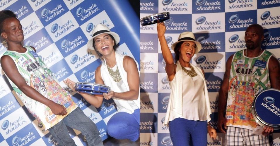 Juliana Paes entrega instrumentos musicais na Cidade de Deus, Rio de Janeiro, ao lado do rapper MV Bill, um dos responsáveis pelo bloco de