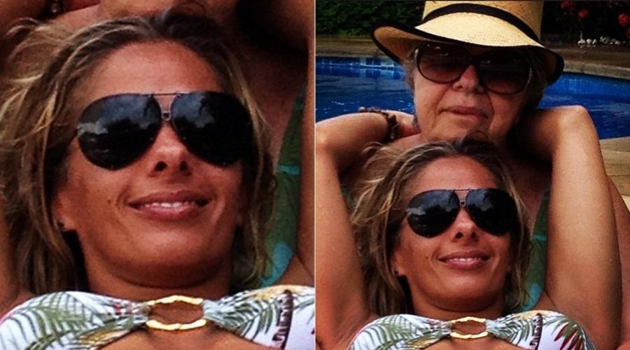Adriane Galisteu relaxa no colo da mãe, Dona Emma, à beira da piscina (24/2/2012)