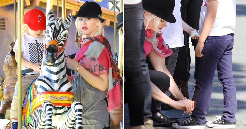 Mãe coruja, a cantora Gwen Stefani leva os filhos a m parque de diversões em Beverly Hills, Califórnia. Gwen anda no carrosel com o filho caçula Zuma e amarra o tênis de Kingston, seu filho mais velho. Os meninos são frutos do casamento da cantora com o vocalista do Bush, Gavin Rossdale (4/3/12)