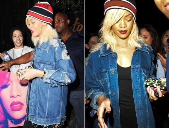 De gorro e jaqueta rasgada, Rihanna é cercada por fãs ao sair de hotel em Nova York (14/3/12)