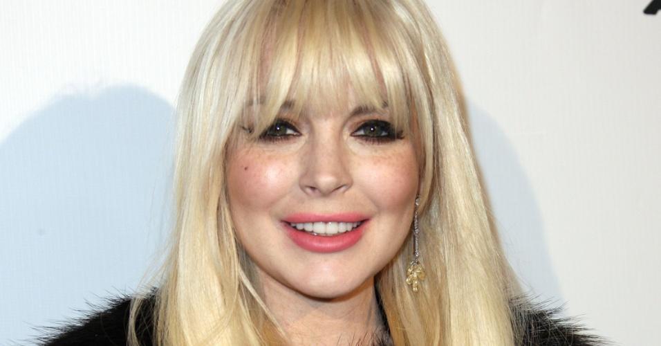 Lindsay Lohan comparece ao evento Domingo Zapata's Oscar Art Show, em Beverly Hills, Califórnia (22/3/12)