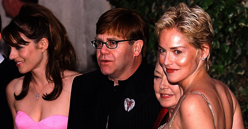 51º Festival Internacional de Cinema de Cannes 1998: From L to R, British actress Elizabeth Hurley, singer Elton John, Mathilde Krim, president of the American Foundation for AIDS Research [AMFAR] and US actress Sharon Stone pose for photographers at the Moulin de Mougins, late 21 May, prior the AMFAR benefit dinner, near Cannes on the French Riviera. [ELECTRONIC IMAGE] AFP PHOTO PASCAL GUYOT-AFP PHOTO