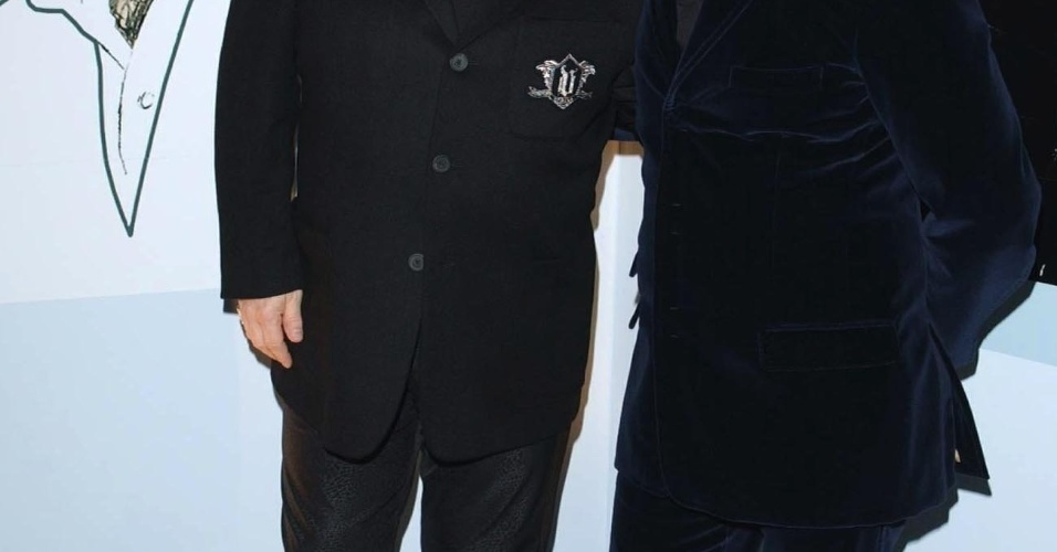 Sir Elton John (L) and songwriting partner Bernie Taupin pose for photographers as they arrive at the Music Industry Trust's Awards and Dinner 2002 at Le Meridien Grosvenor House, Park Lane in London late 04 November 2002. John and Taupin are to be honored at the 11th annual awards presentation organised by the British Phonographic Industry (BPI). AFP PHOTO/IAN WEST