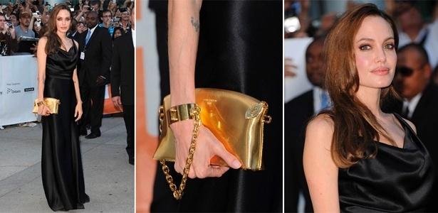 Angelina Jolie é eleita a mais bem-vestida da semana (09 a 15/09/2011) com bolsa Louis Vuitton presa ao pulso - Getty Images
