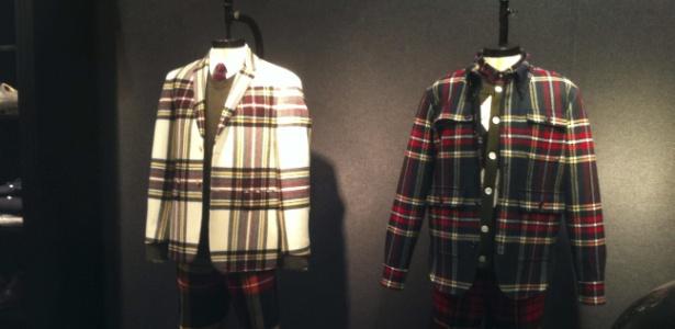 Jaquetas expostas na feira de moda masculina Pitti Uomo em Florença, na Itália, trazem o tradicional xadrez escocês - Carmen Martin/EFE