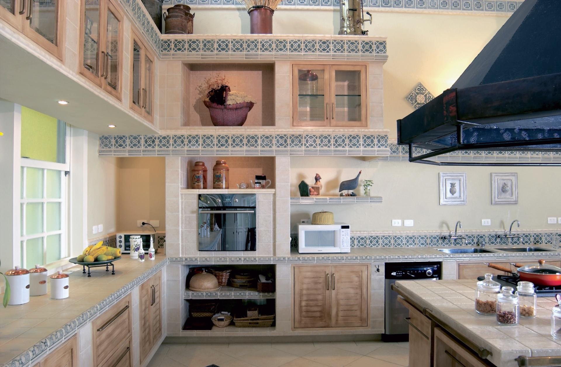 O projeto da cozinha mantém a linguagem de